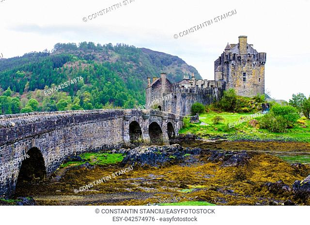 Famous Eilean Donan Castle in Scotland, UK. Situated on a small isle at the meeting point of three sea lochs - Loch Long, Loch Duich and Loch Alsh