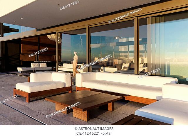 Sofas and table on modern balcony