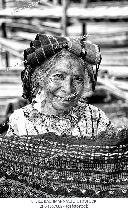 Local humble poor woman portrait with teeth in Lake Atitlan village of San Pedro Guatemala in Central America