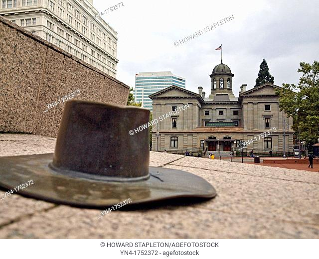 Bronze sculpture of a hat at Pioneer Square  Portland, Oregon  Across the street is the Pioneer Courthouse