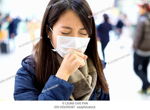 Woman feeling unwell at train station