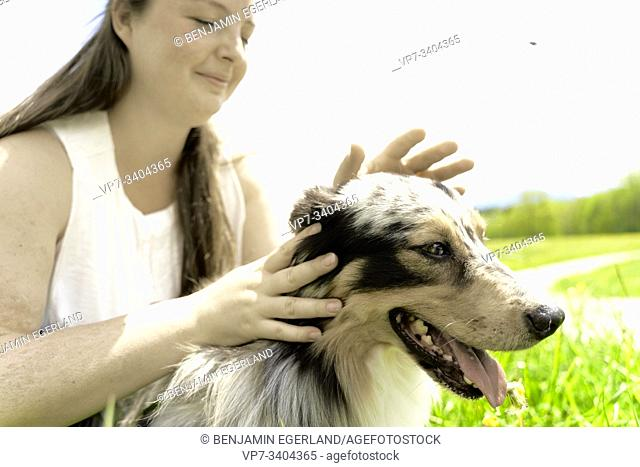 Woman with dog, in Wackersberg, Bavaria, Germany