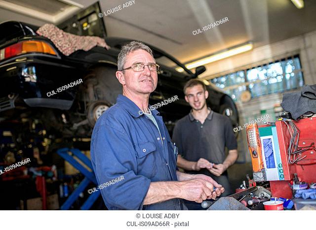 Two mechanics in garage