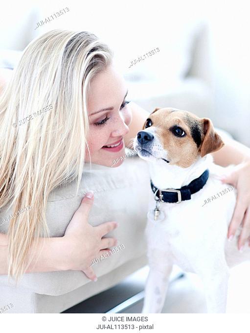 Teenage girl with pet dog