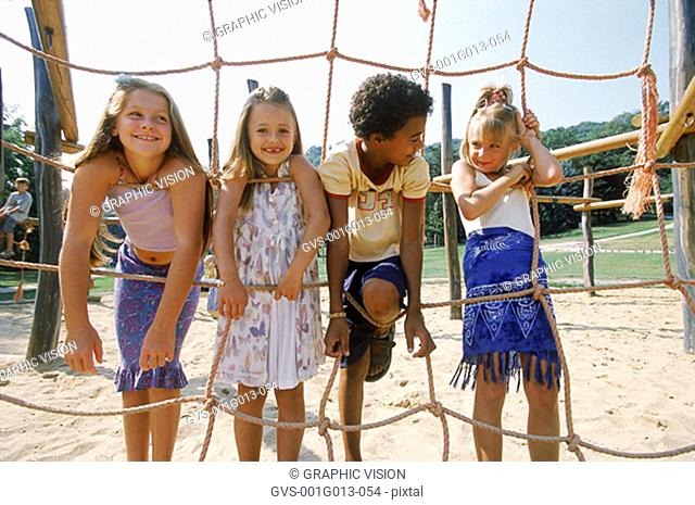 A group of young children playing on a jungle gym