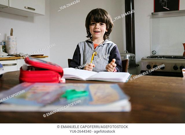 Child does homework in the kitchen