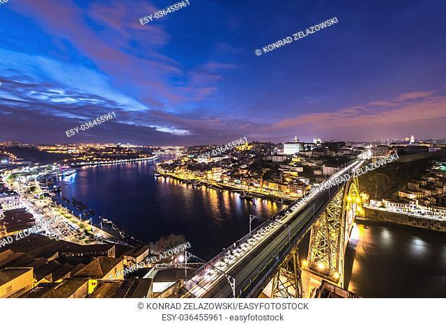 Evening in Porto city, Portugal. Aerial view from Serra do Pilar viewpoint in Vila Nova de Gaia city with Dom Luis I Bridge over Douro River