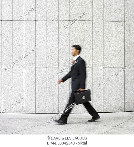 Blurred image of businessman walking
