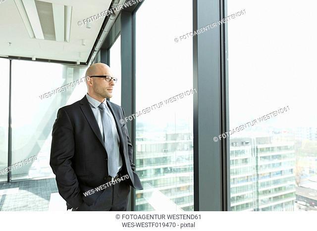 Thoughtful businessman on office floor