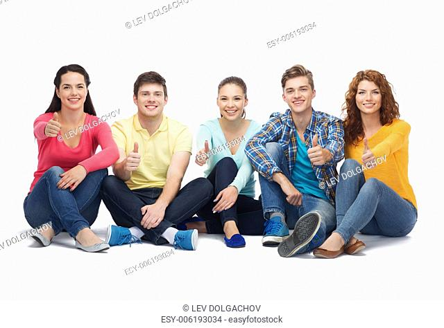 friendship, youth and people - group of smiling teenagers showing thumbs up