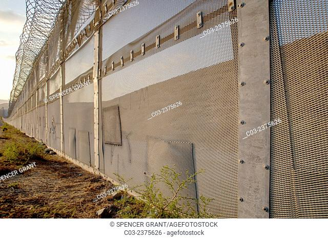 Patched holes in the international fence on the U.S./Mexico border opposite the Colonia Libertad district of Tijuana, Mexico show places where illegal...