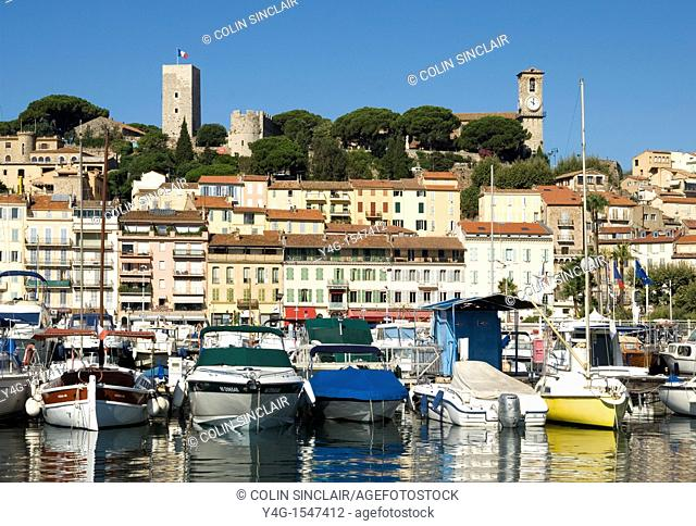 Cannes, harbour, old quarter in background, French Riviera