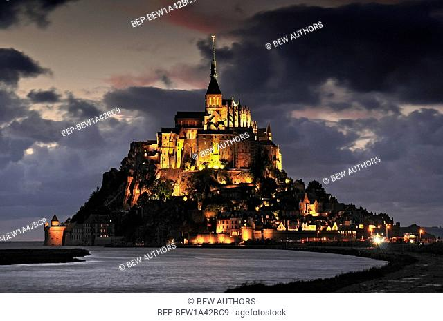 Mont St Michel illuminated at night. Normandy France