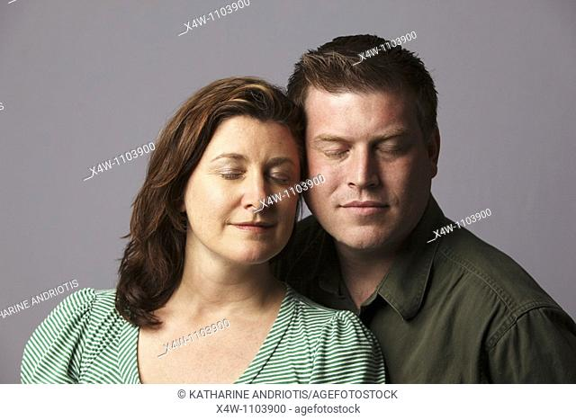 Couple with eyes closed