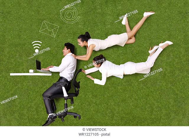 Young people lying on grass in an artificial car