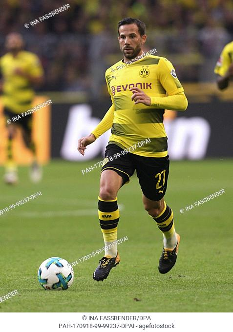 Dortmund's Gonzalo Castro brings the ball up the pitch during the German Bundesliga soccer match between Borussia Dortmund and 1