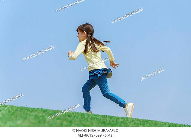 Young Japanese girl and blue sky