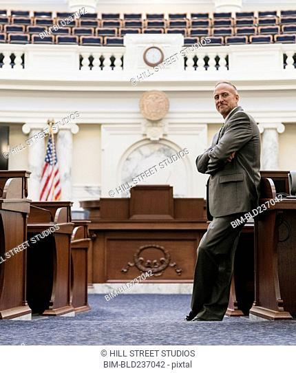 Caucasian politician posing in government chamber