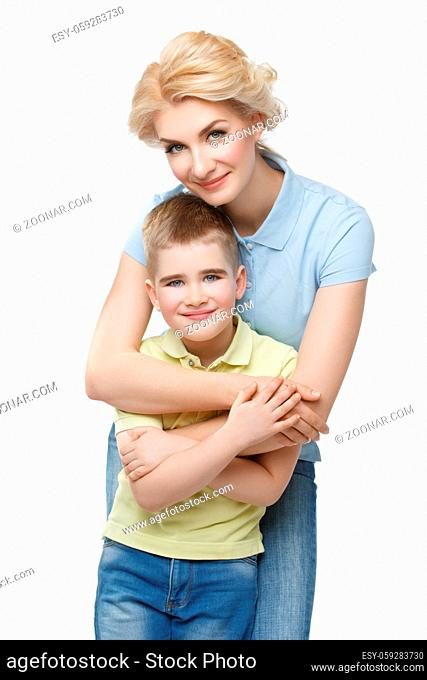 Beautiful blond young woman hugging handsome preschool boy. Mother and son. Happy expression. Isolated on white. Copy space