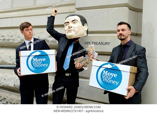 'Move Your Money UK' protest at RBS sell off. Campaign group 'Move Your Money' protest outside the Treasury against George Osborne's sell off of par of the...