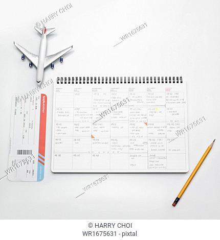 a plane next to a calendar
