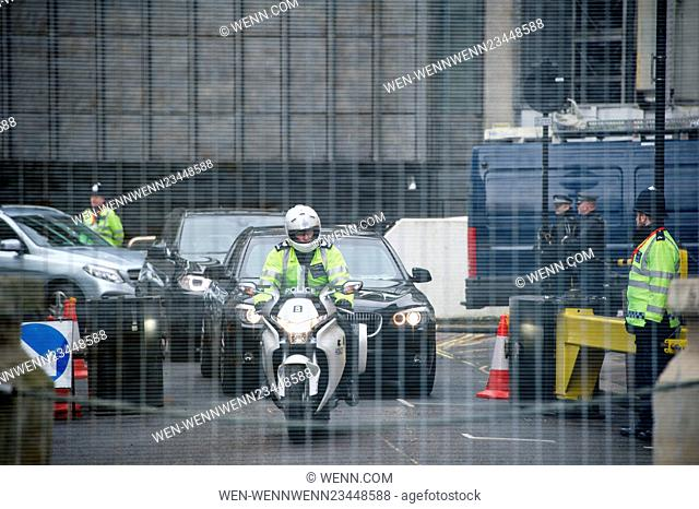 Hundreds of officers, some armed, patrol the perimeter security fence surrounding the Syria Donor Conference (Supporting Syria) at the Queen Elizabeth II...