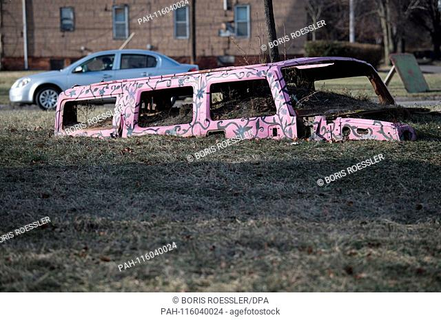 """A """"""""Hummer"""""""" is buried up to the roof on 13 January 2019 in the art project """"""""The Heidelberg Project"""""""" in Detroit.   usage worldwide"""