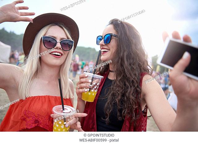 Portrait of women with plastic cups at the music festival