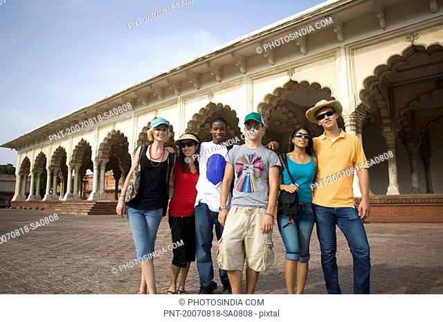 Portrait of three young couples standing in front of a mausoleum, Taj Mahal, Agra, Uttar Pradesh, India