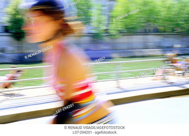Woman rollerblading near the Seine River. Paris. France