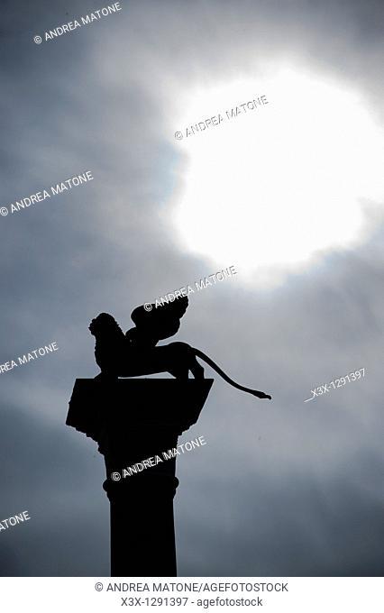 Lion statue side profile  St  Mark's square  Venice  Italy