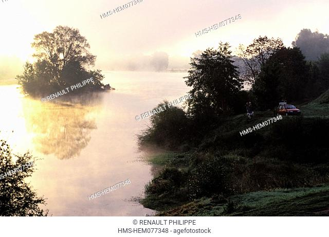 France, Nièvre (58), Nevers, sunrise on the river Loire and its early birds fishermen