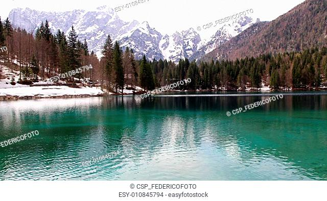 Alpine Lake with crystal clear water and the mountains 2