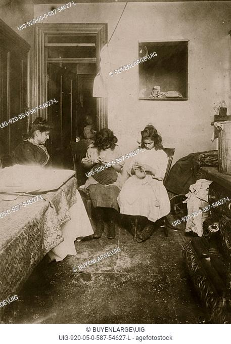 Florence Valentino, 12 yrs. old, and sister Jennie, working on crochet hats in dirty kitchen tenement, 3126 Jerome Ave. Bronx