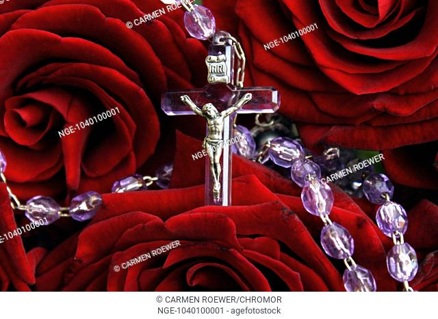 rosary with red rosen
