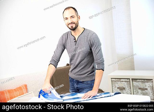 A man ironing his shirt