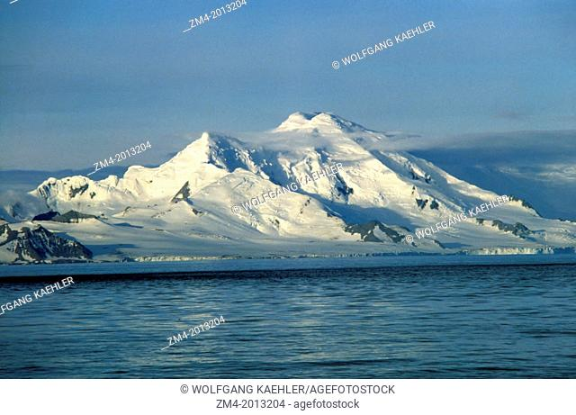 ANTARCTICA, VIEW FROM SEA OF LIVINGSTON ISLAND IN EVENING LIGHT
