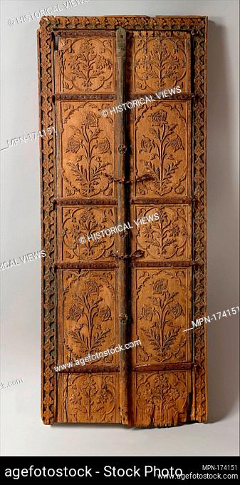 Pair of Flower Style Doors. Object Name: Pair of doors; Date: second half 17th century; Geography: Made in Northern India; Medium: Wood; carved with residues of...