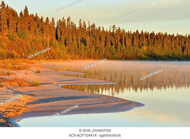 Pine Lake shoreline at sunrise, Wood Buffalo Ntional Park, Alberta, Canada