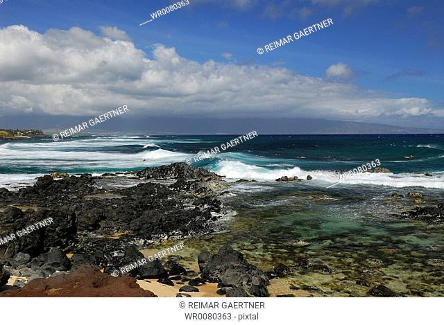 Tide pools waves and surfers Kahalui West Maui from Hookipa Beach