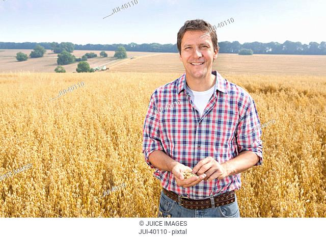 Farmer Inspecting Oat Crop In Field