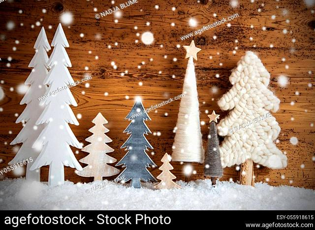 Vintage Christmas Trees. Brown Wooden Rustic Background With Snow And Snowflakes. Christmas Decoration With Stars