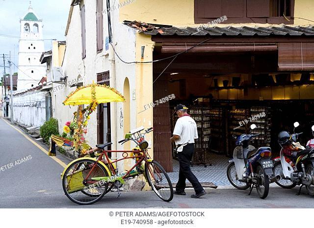 Rickshaw driver in Chinatown, Melaka, Malaysia