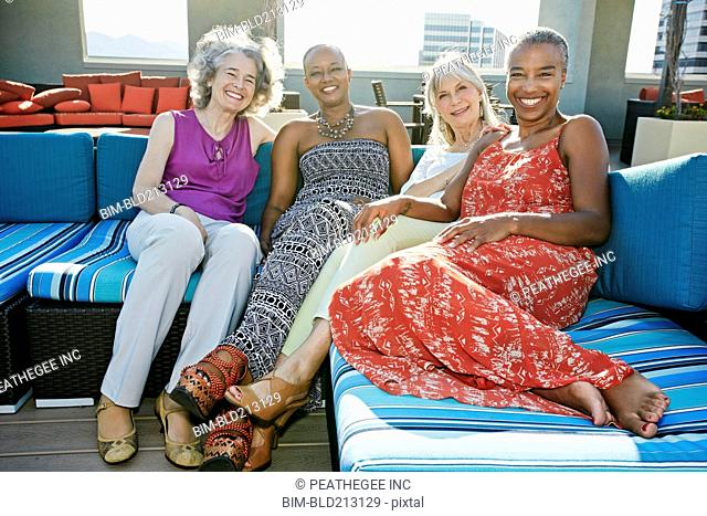 Women relaxing together on urban rooftop