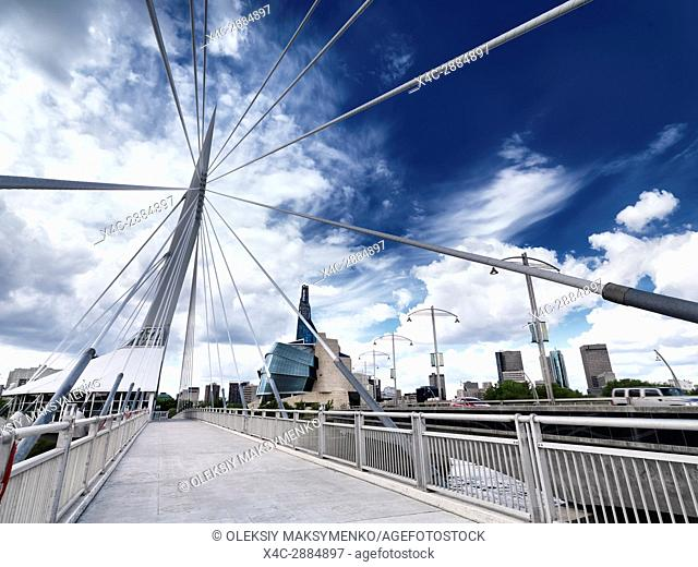 Esplanade Riel Footbridge with beautiful blue sky and the Canadian Museum for Human Rights in the background. Winnipeg, Manitoba, Canada 2017