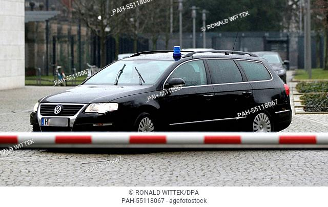 A police vehicle with a flashing blue light leaves the perimeter of the Federal Court of Justice of Germany in Karlsruhe, Germany, 16 January 2015