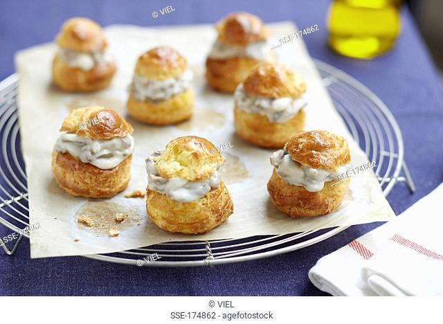 Choux buns with mushroom and diced bacon filling