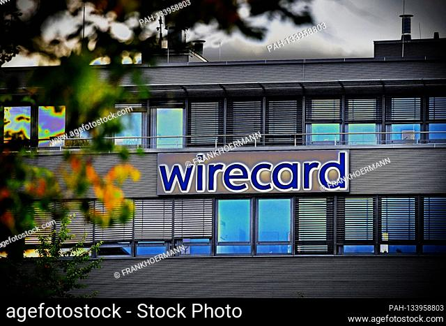 ALIENATION! Evening mood at the headquarters of wirecard AG in Aschheim Dorafter. wirecard logo, company emblem, lettering, building, facade