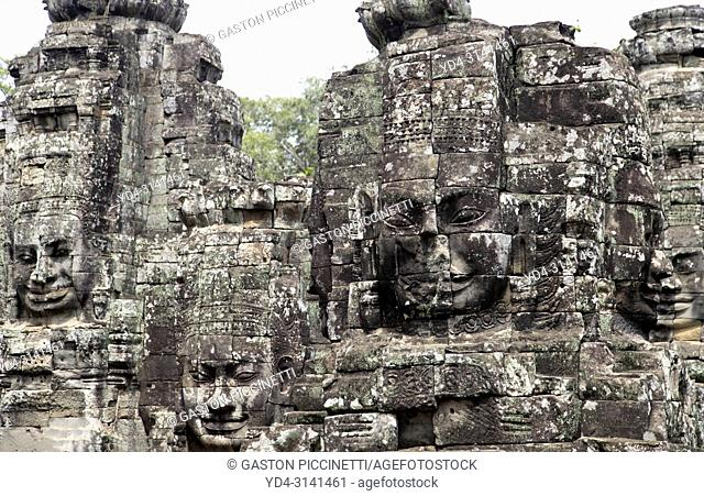 Stone sculptures, faces on the Bayon Temple in Angkor Thom, Angkor Temple Complex, Siem Reap, Cambodia, Southeast Asia. Bayon is a well-known and richly...