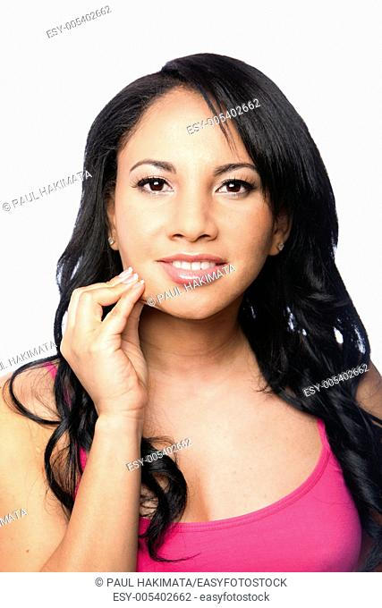 Beautiful young woman pinching healthy skin on cheek showing elasticity, isolated